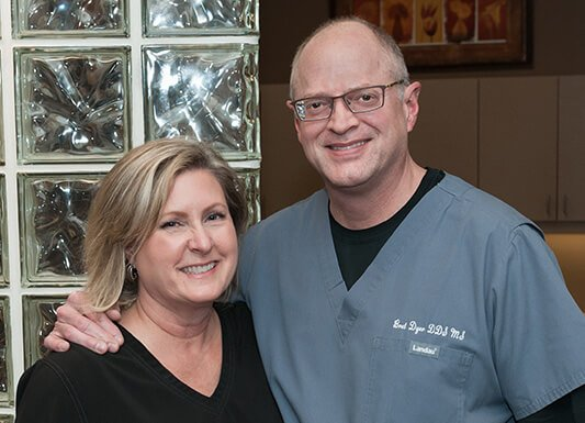 Dr. Bret Dyer and his wife Jacque inside Fort Bend Periodontics and Implantology